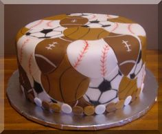 Sports cake - This cake was for a 10 yo boy who likes sports. I thought it was great for that age, not babyish at all. It has a layer of fondant and then the cut out fondant balls on top. I really didnt like the way the black food writer wrote on it. I might try painting with food coloring next time.
