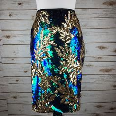 "[Endless Rose] Mermaid Glam Sequin Pencil Skirt Glamorous sequined pencil skirt. Exposed back zip. Lined. Dress it up or pair with your favorite graphic tee for an edgier look.   Color: Iridescent Blue-Green & Gold Fabric: Polyester Size: Large Waist: 15.5"" Hips: 19"" Length: 22.5"" Condition: NWT! No flaws.  No Trades! No PayPal! Endless Rose Skirts Pencil"