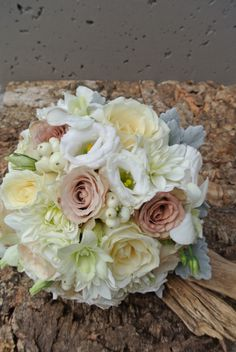 Soft and Pretty. Roses, Lisianthus, Snow Berries and Dusty Miller