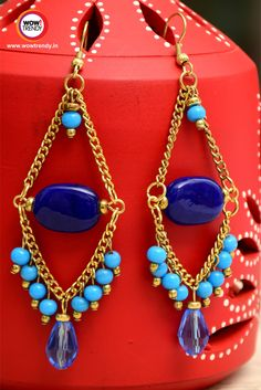 Wowtrendy Light Blue & Golden Color Handcrafted Dangler  The  Blue & Golden earrings dangled ears, jingling like a bell cheeky and charming.  http://www.wowtrendy.in/jewellery/earrings.html