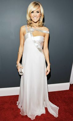 Carrie Underwood wore a white Edition by Georges Chakra gown with Ippolita Silver earrings at the 2010 Grammy Awards.