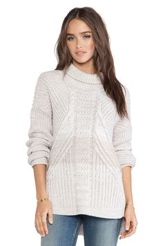 This is a lovely sweater in light grey color. It is baggy in style and is made in 100% merino material. It is a luxury sweater and looks lovely when worn over jeans. You can keep your hair open and wear high heeled long boots along with it. It is available in small, medium and large sizes.