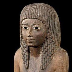 Wood statue of Neferrenpet, Vizier, and High Priest of Ptah from the reign of Ramesses II to the reign of Seti II.His name means 'Good Year'.19th Dynasty, ancient Egypt. Louvre Museum.