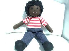 """Cuddly 12"""" Rag Doll - African Boy - This fun loving little rag doll boy has a keen interest in creepy crawlies. Make sure you show him around your garden, he'll have lots to tell you about them!   He comes with a red and white striped t-shirt, dark blue denim styled jeans and black fitted shoes. Fun Loving, Rag Dolls, Red And White Stripes, Denim Fashion, Stuffed Animals, Jeans Style, Blue Denim, Creepy, Dark Blue"""