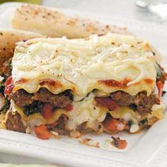 """Spinach and Turkey Sausage Lasagna Recipe -Lynette Randleman's turkey sausage lasagna proves you can layer on great taste while keeping a luscious comfort food light. """"My husband likes it better than the traditional tomato-based version,"""" she adds from Buffalo, Wyoming."""