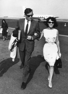 By Edward Quinn Gregory Peck and his wife Veronique arriving at Nice airport 1961