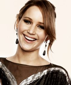 jennifer lawrence; 22 years old and youngest actress for 2 Oscar Nominations and she still has a level head, a pure heart, and an addicting smile!  Plus she is FREAKING Hilarious!!! Just watch some of her interviews!