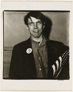 Diane ARBUS,  Patriotic young man with a flag, N.Y.C.  1967