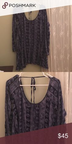 Urban outfitters bohemian tunic Blue flowy bohemian tunic. Actually reads as small but is flowing I'm a medium and it fits! Lightly worn due to washing. Urban Outfitters Tops