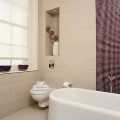 Update a simple scheme by contrasting colourful mosaics with plain, large-scale wall tiles. Pick out an accent colour with coordinating accessories.