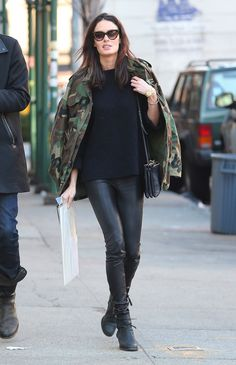 camo jacket, leather pants and black sweater.