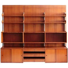 Italian Mid-Century Teak Wall Unit, 1960s | From a unique collection of antique and modern bookcases at https://www.1stdibs.com/furniture/storage-case-pieces/bookcases/