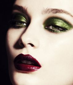 green metallic eyes and burgundy lips