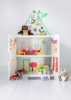 With a little imagination + a few rolls of washi tape, you can hack an IKEA cabinet into an adorable dollhouse.