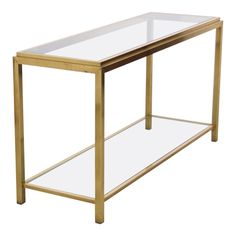Large Maison Jansen  Two-Tier Brass and Glass Console Table | From a unique collection of antique and modern shelves at https://www.1stdibs.com/furniture/storage-case-pieces/shelves/