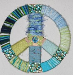 Wooden Peace Sign Decor hand decorated in yarn and gems for teen's or peace lovers's wall