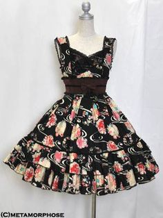 Kimono Print Crossover Front Pinafore Dress ~ $311  Although it looks more brown in the image, the obi sash is actually wine colored. I think this is the first wa-lolita dress I've seen that doesn't have the giant kimono sleeves.  I really love this.