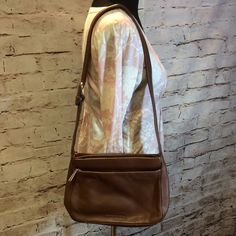 STONE MOUNTAIN BROWN LEATHER PURSE Beautiful buttery soft leather bag with lots and lots of storage compartments.. 3 separate compartments inside with organizing pockets and 2 outside pockets. Like new Color is Nutmeg Stone Mountain Bags Shoulder Bags