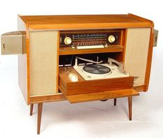 """Vintage stereo cabinet """"had integrated speakers, a turntable and a big radio. When the cabinet was closed it looked like just another piece of furniture."""