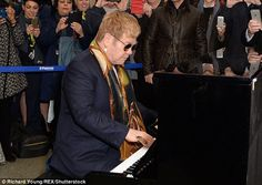 The star, who recently announced plans to 'phase out' his career' wore a blue suit and a c...