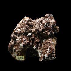 https://www.minfind.com/mineral-565445.html  Ferroan dolomite