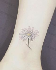 Daisy ankle tattoo by Tattooist Flower