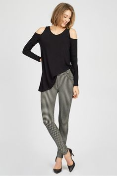 Patterned leggings and a cool cold shoulder top is a fun look