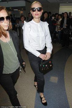 Kate Bosworth wearing Carven Black Patent Leather Shoes, Christopher Kane Devine Bag and Celine Cl41097 Strat Screen Sunglasses