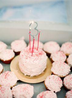 I like this simple, homespun birthday cake + cupcakes idea.