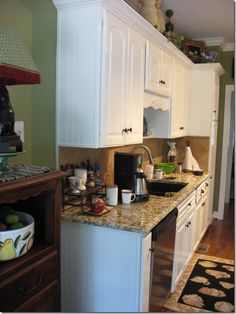Add beadboard wallpaper on end cabinets in kitchen and bathroom for extra detail.