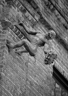 Gargoyle I find this gargoyle quite freaky the way it's like it's ripped the other face if the wall and is hanging on to the building. I also like the expression on his face.