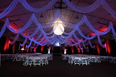 Custom event draping in white chiffon by W Drapings for a wedding reception in a sporting facility in Central Florida. Photo by Concept Photography.