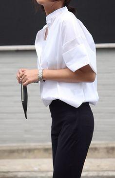 White shirt & black trousers.