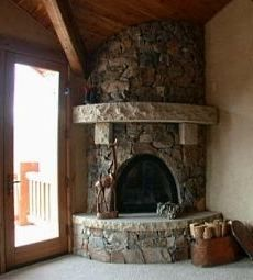 I like the interesting oval style stone  fireplace....in the corner!  Beautiful!