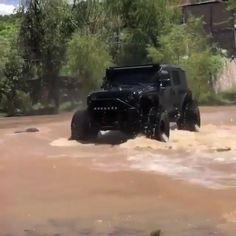 Jeep Wrangler crossing river