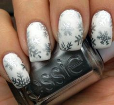 Elegant Silver Snowflakes Nail Art. For more ideas, visit www.nailartbank.com
