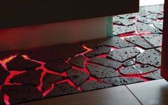 Stone set on a glass sheet that is lit red by LED lighting--The floor is lava! Totally want a lava floor in the tiki room. Lava Floor, The Floor Is Lava, Inventions Sympas, Cool Inventions, Future Inventions, Game Room, Home Projects, Home Goods, Home Improvement
