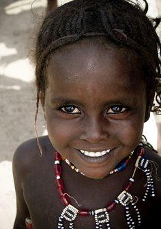 Young Afar girl smiling, Ethiopia