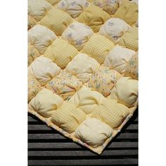 This style of quilt is called a biscuit or puffball quilt. My grandmother found instructions for making this style of quilt in a magazine from the early I like it for its soft/fluffy feel vs. the typical, flat, heavy feel of a traditional quilt. Yellow Theme, Baby Yellow, Mellow Yellow, Baby Quilt Patterns, Fabric Patterns, Sewing Patterns, Biscuit Quilt, Puffy Quilt, Baby Puffs