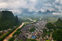 """View of the Li River over the small town of Xingping, near Yangshuo, China.  This region of Guangxi province is known primarily for the hundreds of karst peaks that dominate the landscape of Southern China.  <a href=""""http://www.peterstewartphotography.com"""">www.peterstewartphotography.com </a> <b> Follow my latest updates on: </b> <a href=""""http://facebook.com/PeterStewartPhotography""""> Facebook  