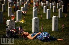 The Living and the Dead  A young woman lies on the grave of U.S. Marine Lance Cpl. Noah Pier on Memorial Day at Arlington National Cemetery on May 31 in Arlington, Va. Pier was killed February 12 in Marja, Afghanistan.