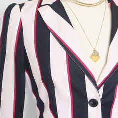 Tommy Hilfiger Striped Blazer Red, white, blue and the palest of pinks!  Such a cool touch to this versatile piece.  Wear it preppy, then pair it with a concert tee and wear it rocker.  Or you can take a page from my dress form's book and wear it low and sexy.  See?  Versatile!  I found a very faint demarcation on one sleeve. Tommy Hilfiger Jackets & Coats Blazers