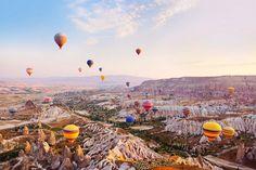 Float on a hot air balloon in Cappadocia, Turkey.