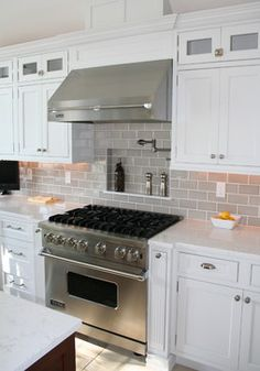 gray subway tile and quartz counters