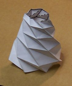 """iece by Ian Stewart about a new breed of mathematically inspired origami. Stewart begins by reminding us of the mathematical complexity hidden in this ancient Japanese art. """"The basic problem of origami is the flat-folding problem: given a diagram of fold lines on a flat sheet of paper, can the paper be folded into a flat shape without introducing any further creases? ... [T]his question is ....an example of an NP-hard problem."""" Taketoshi Nojima (Department of Aeronautics and Asto.."""