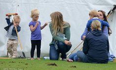 Mia Tindall with polo stick and Autumn and Isla Phillips. They are with the Duchess of Cambridge, Zara Phillips and Prince George to watch Prince William and Prince Harry play at Festival of Polo at the Beaufort Polo Club, Gloucestershire