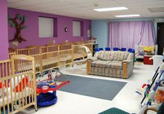 I love the colors in the room and the openness for the babies to crawl and move around.