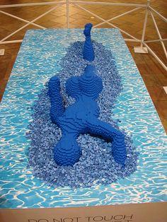 Swimming Lego sculpture, by artist Nathan Sawaya