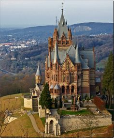 "Dragon Castle,, Germany | Schloss Drachenburg castle overlooking the Rhine River at Königswinter, opposite the former West German capital, Bonn. It was built in just three years between 1881 and 1884 by a wealthy stockbroker, Stephan Sarter. Dubbed the ""Neuschwanstein of the Rhine,"" it is regarded as a prime example of historicism, a 19th century trend that replicated various architectural styles to create idealized historical buildings."