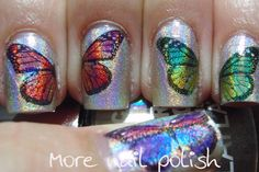 Holographic Butterflies - Tutorial all u have to do is get temporary tattoos and stick them to your holographic nails and wet the tattoo like u would do on a normal rep tattoo would do and top coat its easy and pretty